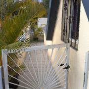 Le portillon en haut de l'escalier